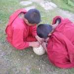 2 monks trying to fix the leaking football
