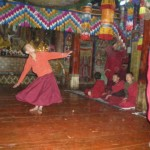 The younger monks are taught Lama dancing by one of the older students