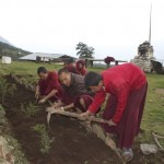 Lama Namgay teaching the monks gardening techniques