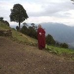 Lama Namgay looking proudly onto the newly tilled vegetable plot in readiness for the organic gardening lessons